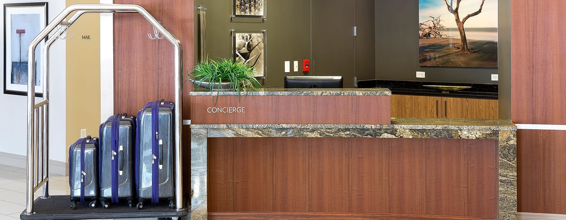 concierge counter with wooden accents and a luggage rack