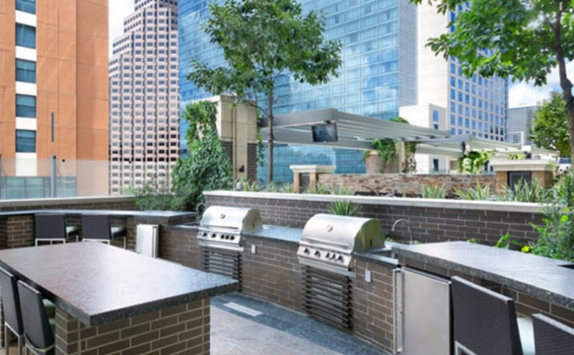 skydeck lounge with grill stations and skyline city views