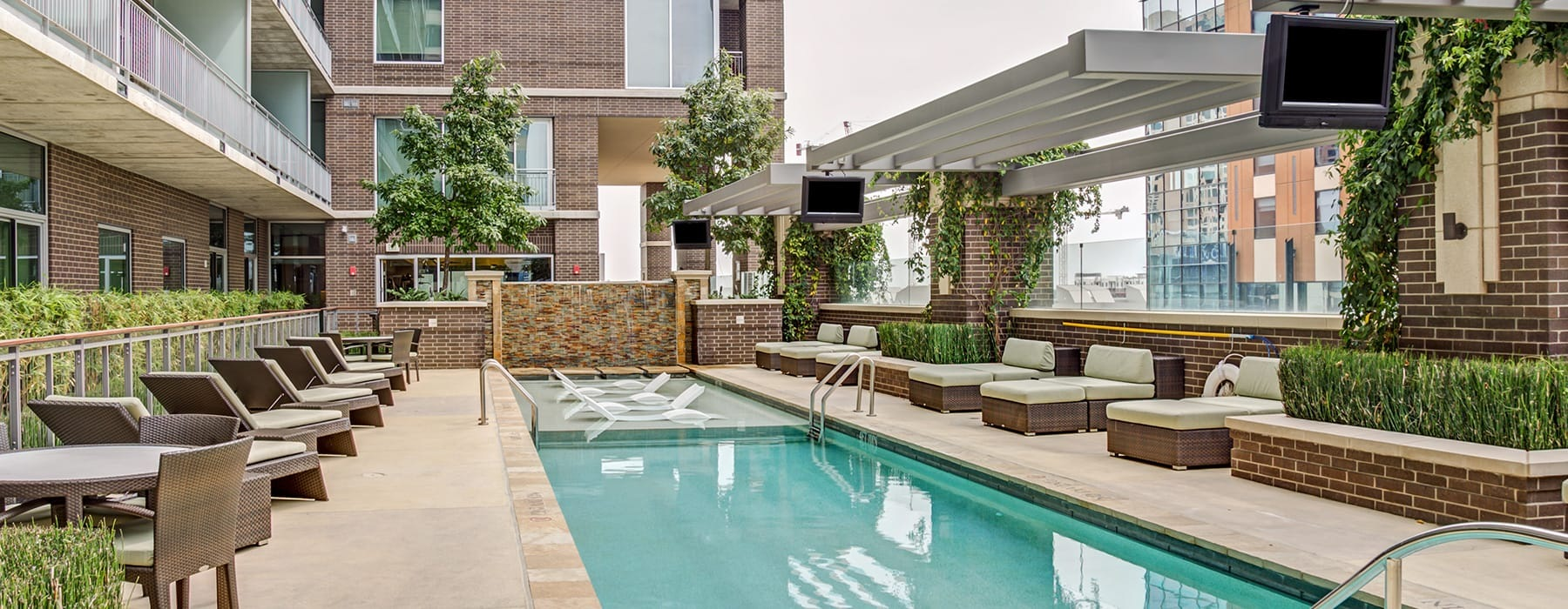 spacious swimming pool with near landscaping and ample reclining seats